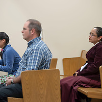 Former followers of the religious sect Aggressive Christianity Hannah Jordan, front row far, Joshua Green, front row near, and Elizabeth McCreary, listen to the testimony of James Green during his sentencing hearing at the 13th Judicial District Courthouse in Grants on Friday.