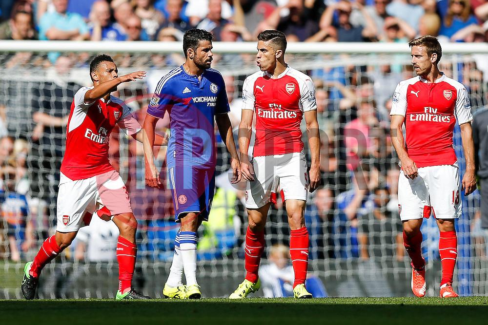 Diego Costa of Chelsea and Gabriel Paulista of Arsenal argue - Mandatory byline: Rogan Thomson/JMP - 07966 386802 - 19/09/2015 - FOOTBALL - Stamford Bridge Stadium - London, England - Chelsea v Arsenal - Barclays Premier League.