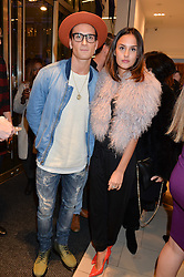 OLIVER PROUDLOCK and LUCY WATSON at the #PandoraWishes Campaign Launch Event, Pandora Marble Arch flagship store, London on 12th November 2014.