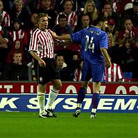 Photo: Richard Lane.<br />Southampton v Steaua Bucharest. UEFA Cup. 24/09/2003.<br />Graeme Le Saux and Raducanu continue their feud through the first half.