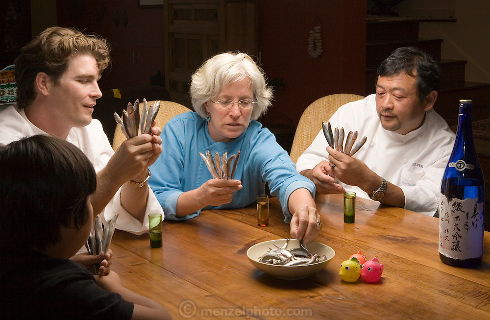 """Sean Knight plays """"Go Fish"""" and drinks saki with partners and fellow chefs Cindy Pawlcyn and Ken Tominaga at Cindy's St. Helena home in the Napa Valley, CA. They are about to open a new restaurant in St. Helena, called Go Fish. Also playing is Ken's 9 year old son.."""