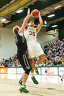 Vermont's Payton Henson (35) leaps over Dartmouth's Evan Boudreaux (12) to take a shot during the men's basketball game between the Dartmouth Big Green and the Vermont Catamounts at Patrick Gym on Wednesday December 7, 2016 in Burlington (BRIAN JENKINS/for the FREE PRESS)