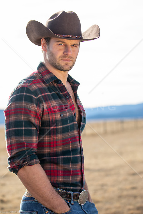 portrait of a chiseled All American cowboy outdoors