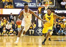 Jan 20, 2018; Morgantown, WV, USA; Texas Longhorns forward Mohamed Bamba (4) dribbles down the floor during the first half against the West Virginia Mountaineers at WVU Coliseum. Mandatory Credit: Ben Queen-USA TODAY Sports
