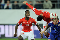 05.03.2014, AFG Arena, St. Gallen, SUI, Testspiel, Schweiz vs Kroatien, im Bild Johan Djourou (SUI) mit Blerim Dzemaili, Ivan Rakitic // during the International Friendly match between Switzerland and Croatia at the AFG Arena in St. Gallen, Switzerland on 2014/03/06. EXPA Pictures © 2014, PhotoCredit: EXPA/ Freshfocus/ Andy Mueller<br /> <br /> *****ATTENTION - for AUT, SLO, CRO, SRB, BIH, MAZ only*****