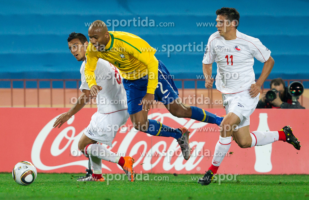 Maicon of Brazil between Arturo Vidal and Mark Gonzalez of Chile during the 2010 FIFA World Cup South Africa Round of Sixteen match between Brazil and Chile at Ellis Park Stadium on June 28, 2010 in Johannesburg, South Africa.  (Photo by Vid Ponikvar / Sportida)