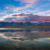 Sunrise at Big Alkali Lake (near Mammoth Lakes, CA) first light on the mountains with storm clouds over the Sierra's