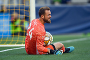Stefan Frei (24) of Seattle Sounders makes a stop during the MLS soccer match against the LA Galaxy on Saturday, September 1, 2019, in Seattle, Washington. (Alika Jenner/Image of Sport via AP)