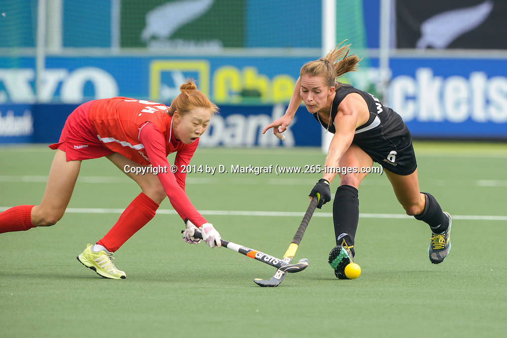 The Hague, Netherlands, June 02: Petrea Webster #6 of New Zealand fights for the ball  during the field hockey group match (Group A) between Korea and New Zealand¥s Black Sticks on June 2, 2014 during the World Cup 2014 at GreenFields Stadium in The Hague, Netherlands. Final score 1:0 (1:0) (Photo by Dirk Markgraf / www.265-images.com) *** Local caption ***