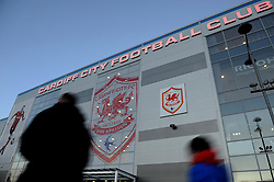 Cardiff City fans walk past the Cardiff City Stadium - Photo mandatory by-line: Dougie Allward/JMP - Tel: Mobile: 07966 386802 28/12/2013 - SPORT - FOOTBALL - Cardiff City Stadium - Cardiff - Cardiff City v Sunderland - Barclays Premier League