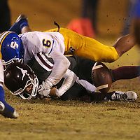 Lauren Wood | Buy at photos.djournal.com<br /> Kossuth quarterback Matthew Bobo is tackled by Booneville's Mason Foster forcing a fumble during Friday night's game at Kossuth.