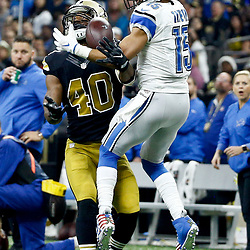 Dec 4, 2016; New Orleans, LA, USA; Detroit Lions wide receiver Golden Tate (15) catches a pass over New Orleans Saints cornerback Delvin Breaux (40) during the first quarter of a game at the Mercedes-Benz Superdome. Mandatory Credit: Derick E. Hingle-USA TODAY Sports