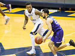 Jan 7, 2017; Morgantown, WV, USA; West Virginia Mountaineers guard Daxter Miles Jr. (4) applies pressure to TCU Horned Frogs guard Alex Robinson (25) during the first half at WVU Coliseum. Mandatory Credit: Ben Queen-USA TODAY Sports