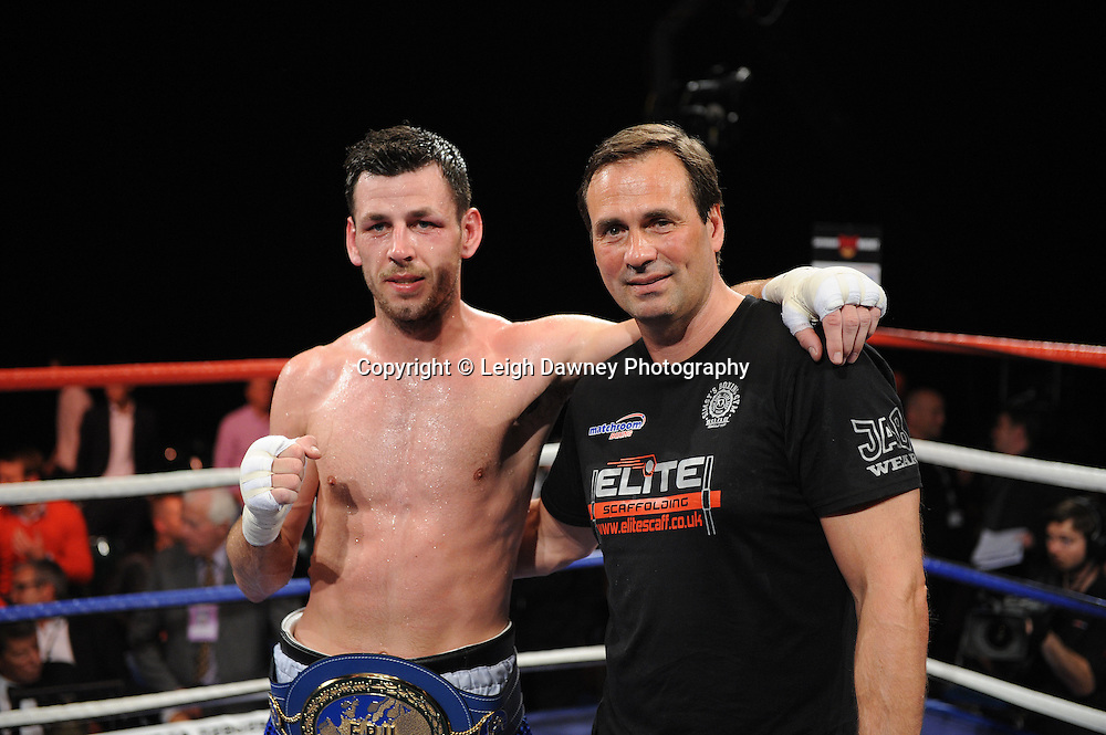 Darren Barker pictured with trainer after defeating Domenico Spada at London's Olympia on Saturday 30th April 2011 for the European Middleweight Championship. Matchroom Sport. Photo credit © Leigh Dawney.