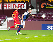 Scotland's Jason Cummings gets a header on target during Scotland Under-21 v FYR Macedonia,  UEFA Under 21 championship qualifier  at Tynecastle, Edinburgh. Photo: David Young<br /> <br />  - &copy; David Young - www.davidyoungphoto.co.uk - email: davidyoungphoto@gmail.com