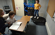 Adam Jones, right, age 7, and Jeffrey Jones, age 9, are seen with their private tutor/therapist Edith Conroy in the basement of their home that they use as a classroom in Toms River, NJ. Adam jumps on a trampoline to calm himself down.<br />