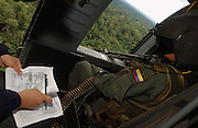 Colombian government coca verification flight from Tumaco airfield east into the jungle of Nari&ntilde;o.<br />Flying in a Colombian army Blackhawk helicopter, with an escort of three Huey helicopter gunships. Using GPS devices, Colombian authorities verify the presence of coca farms deep in the leftist-guerilla FARC-held jungle.<br />In each location, coca was found. This is 'hot' mission needing to fly low for visual verification. On the previous day the helicopter was hit twice by FARC ground-fire.