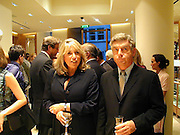 Eve Pollard and Nick Lloyd. Burberry Bond St. Launch party. 21-23 New Bond St. London. In Support of the Sargent Cancer Care for Children. 7/9/00 © Copyright Photograph by Dafydd Jones 66 Stockwell Park Rd. London SW9 0DA Tel 020 7733 0108 www.dafjones.com