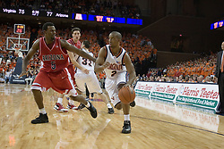 Virginia's J.R. Reynolds (2) dribbles around Arizona's Jawann McClellan (5).  UVA defeated the #10 ranked Wildcats 93-90 in the first game at the new John Paul Jones Arena, in Charlottesville, VA on November 12, 2006...