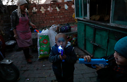 Ethnic Uighur children play with toys in Turpan, Xinjiang Uighur Autonomous Province, China, 17 November 2017. Uighurs, a Muslim ethnic minority group in China, make up about 40 per cent of the 21.8 million people in Xinjiang, a vast, ethnically divided region that borders Pakistan, Afghanistan, Kazakhstan, Kyrgyzstan and Mongolia. Other ethnic minorities living in here include the Han Chinese, Kyrgyz, Mongolian and Tajiks people. Xinjiang has long been subjected to separatists unrests and violent terrorist attacks blamed by authorities on Islamist extremism while human rights groups say Chinese repression on religious rights, culture and freedom of movement caused undue tensions. Life however goes on under the watchful eye of the government for the ethnic Uighurs living in the city of Urumqi and surrounding areas and the region is still considered an attractive tourist spot. A recent report by state media Xinhua news agency claims Xinjiang received more than 100 million tourists in 2017, 'the highest figure in its history'.