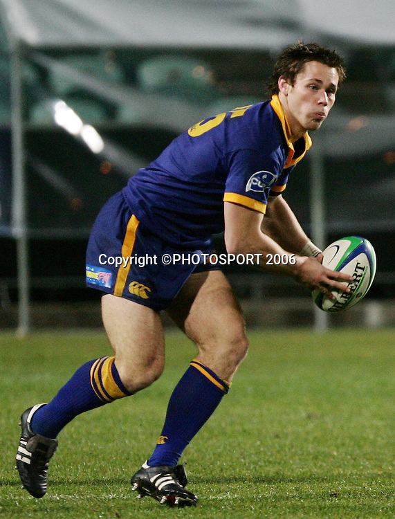 Otago fullback Craig Clare looks to pass during the Air New Zealand Cup pre season game between QBE Insurance North Harbour and Speight's Otago held at North Harbour Stadium in Auckland, New Zealand on Friday 14 July 2006. Photo: Tim Hales/PHOTOSPORT