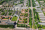 Nederland, Noord-Holland, Amsterdam, 14-06-2012; Slotervaart met de Cormelis Lelylaan en de flats aan de Comeniusstraat (rechts).  In het midden (vlnr) Johan Huizingalaan. In het midden van boven naar beneden de Pieter Calandlaan, langs het Sierplein..This residential area (Slotervaart) is an example of garden cities of Amsterdam-west. Constructed on the basis of the General Extension Plan for Amsterdam (AUP, 1935). Example of the New Building (het Nieuwe Bouwen), detached in strips, oblong housing blocks alternated with green areas, built in fifties and sixties of the 20th century. ..luchtfoto (toeslag), aerial photo (additional fee required).foto/photo Siebe Swart