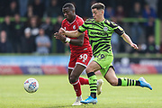 Crawley Town'sBeryly Lubala(30) and Forest Green Rovers Jack Aitchison(29), on loan from Celtic during the EFL Sky Bet League 2 match between Forest Green Rovers and Crawley Town at the New Lawn, Forest Green, United Kingdom on 5 October 2019.