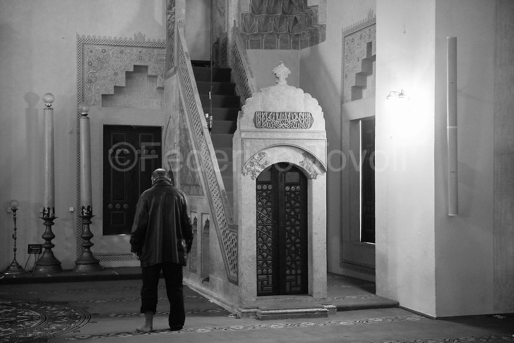 Solitary prayer in the biggest mosque in town