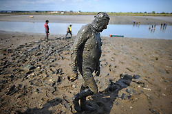 © London News Pictures. 05/05/2013. Malden, UK. Competitors take part in the Maldon Mud Race in Maldon, Essex on May 05, 2013. The race originated in 1973 and involves competitors racing around a course on the mudbanks of the river Blackwater at low tide. Photo credit: Ben Cawthra/LNP.
