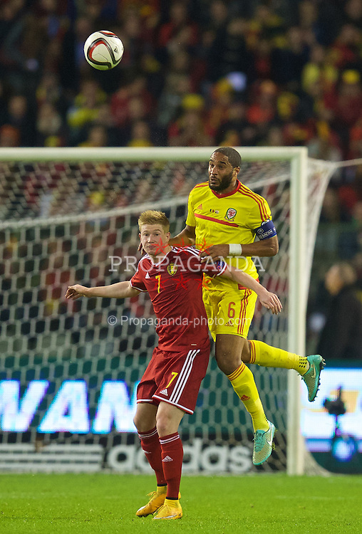 BRUSSELS, BELGIUM - Sunday, November 16, 2014: Wales' captain Ashley Williams in action against Belgium's Kevin De Bruyne during the UEFA Euro 2016 Qualifying Group B game at the King Baudouin [Heysel] Stadium. (Pic by David Rawcliffe/Propaganda)