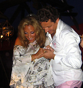 **EXCLUSIVE**.Denise Rich dancing up a Storm with Olivier Bernasconi at Le Ti St Barth Restaurant.St. Barth, Caribbean.Saturday, December 01, 2007.Photo By Celebrityvibe.com.To license this image please call (212) 410 5354; or.Email: celebrityvibe@gmail.com ;.website: www.celebrityvibe.com