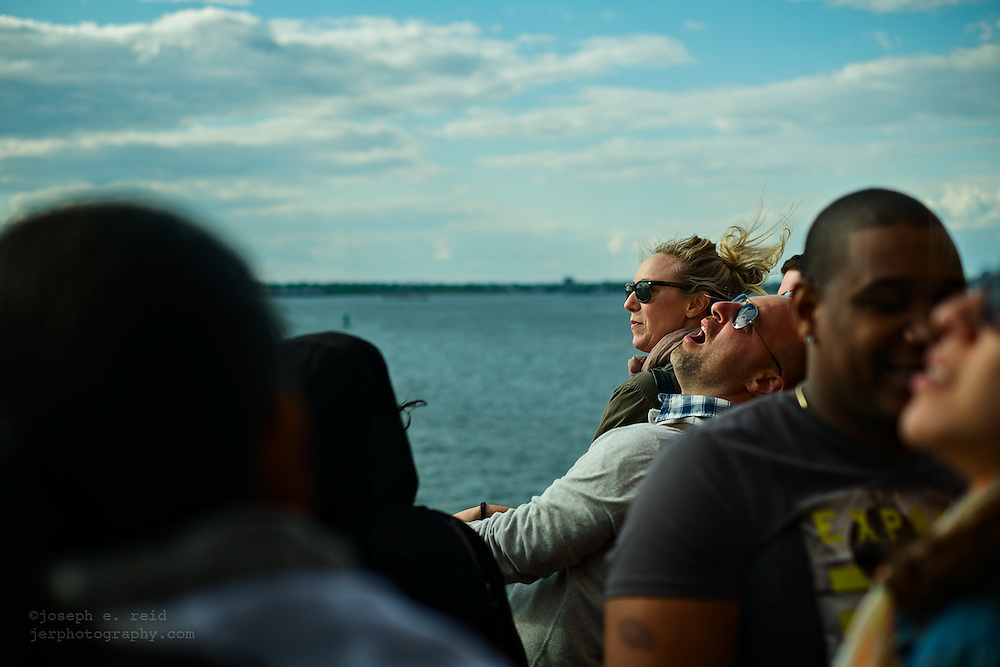 Man on ferry looking at sky with mouth open, New York, NY, US