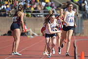 Apr 28, 2018; Philadelphia, PA, USA; Siofra Cleirigh Buttner takes the handoff from McKenna Keegan on the anchor leg of the Villanova women's 4 x 800m relay that won the Championship of America race in 8:19.98 during the 124th Penn Relays at Franklin  Field.