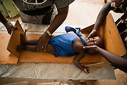 The height of a child gets measured to monitor growth at the Pujehun Government hospital in Pujehun, Sierra Leone on Friday March 19, 2010..