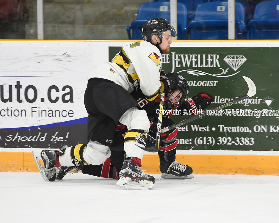 TRENTON, ON  - MAY 5,  2017: Canadian Junior Hockey League, Central Canadian Jr. &quot;A&quot; Championship. The Dudley Hewitt Cup. Game 7 between Georgetown Raiders and the Powassan Voodoos. Justin Schebel #2 of the Powassan Voodoos makes the hit on Jack Hughes #16 of the Georgetown Raiders during the first period.   <br /> (Photo by Andy Corneau / OJHL Images)