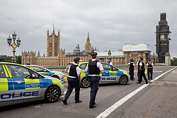 © Licensed to London News Pictures. 14/08/2018. London, UK. Police on the south side of Westminster Bridge after a car crashed into security barriers in Parliament Square. Counterterrorism police are reportedly leading the investigation. Photo credit: Rob Pinney/LNP
