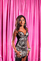 RICCIONE, ITALY - 24 AUGUST, 2011: Sonia, 56, participates at Miss Chirurgia Estetica (Miss Plastic Surgery), a plastic surgery beauty pageant at the Beach Cafe in Riccione, Italy.