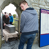 James Kelly and Matthew Egan carry the time capsule into the cathedral grounds