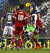 Picture by David Horn/Focus Images Ltd +44 7545 970036<br /> 03/12/2013<br /> Mark Beevers of Millwall (2nd right) goes close with a headed effort early on during the Sky Bet Championship match at The Den, London.