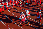 The start included a lap of the track - 2000 Santas of all ages take part in the annual Santa Run in Battersea Park to support Noah's Ark Children's Hospice.