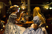 UNITED KINGDOM, London: 24 October 2015. <br /> Comic Con Feature.<br /> Cosplay fans dressed as Cinderella have drink in a bar on the second evening of the MCM London Comic Con.<br /> Photo: Rick Findler / Story Picture Agency