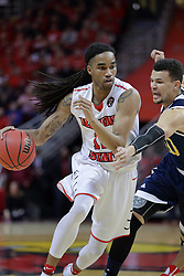15 March 2017:  Tony Wills(12) drives past Luke Nelson during a College NIT (National Invitational Tournament) mens basketball game between the UC Irvine Anteaters and Illinois State Redbirds in  Redbird Arena, Normal IL