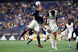 August 11, 2018 - Foxborough, MA, U.S. - FOXBOROUGH, MA - AUGUST 11: New England Revolution midfielder Teal Bunbury (10) heads the ball over Philadelphia Union defender Auston Trusty (26) during an MLS match between the New England Revolution and the Philadelphia Union on August 11, 2018, at Gillette Stadium in Foxborough, Massachusetts. The Union defeated the Revolution 3-2. (Photo by Fred Kfoury III/Icon Sportswire) (Credit Image: © Fred Kfoury Iii/Icon SMI via ZUMA Press)