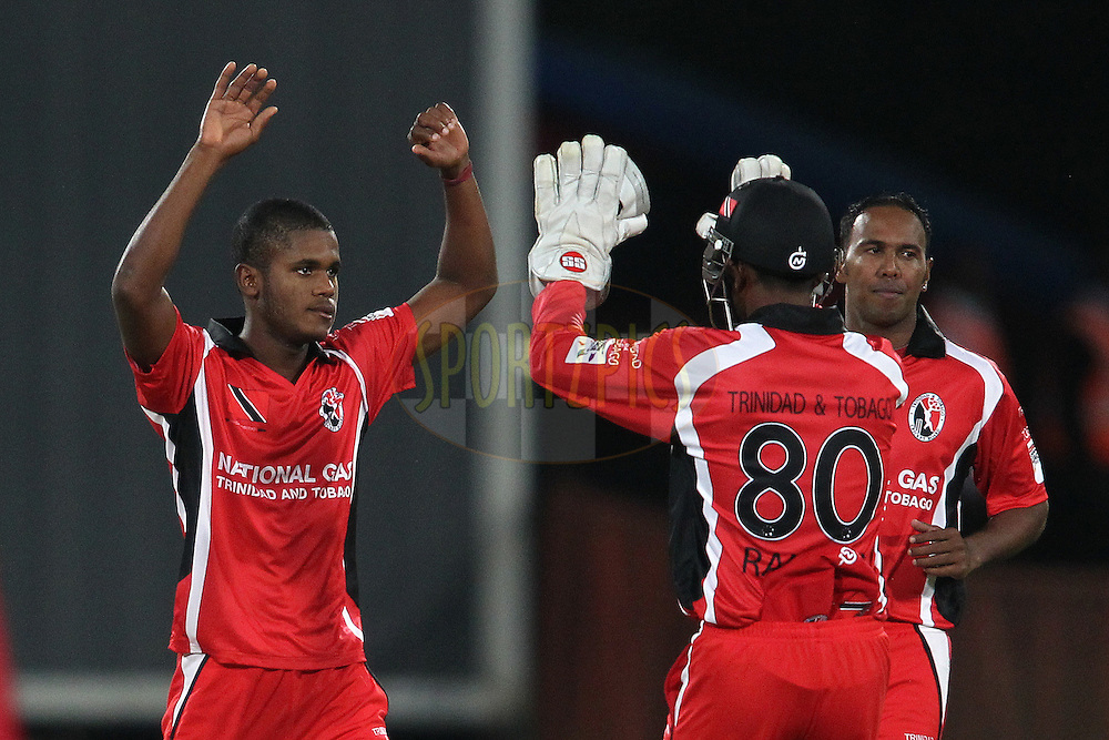 Yannick Ottley of Trinidad & Tobago celebrates with Trinidad & Tobago captain Denesh Ramdin after getting Joe Root of Yorkshire Carnegie wicket during the 4th Qualifying match of the Karbonn Smart CLT20 South Africa between Trinidad & Tobago and Uva Next held at Supersport Park Stadium in Centurion, South Africa on the 10th October 2012..Photo by Shaun Roy/SPORTZPICS/CLT20