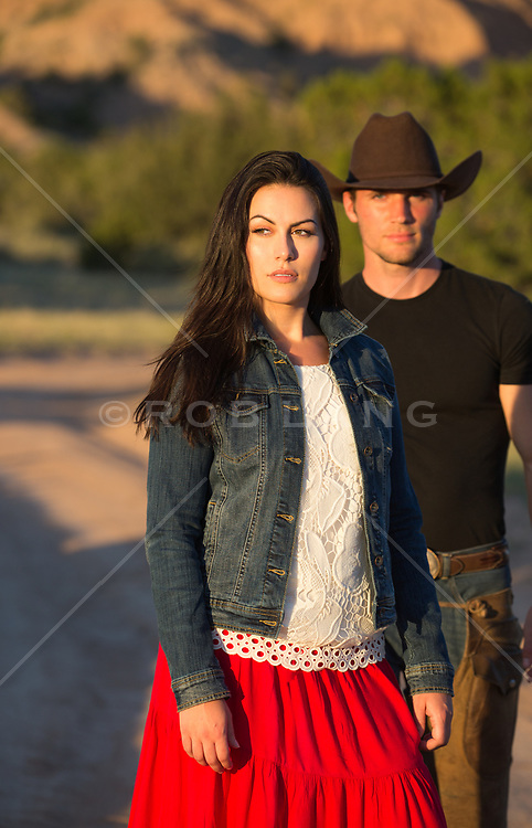 hot cowboy approaching a beautiful girl outdoors