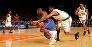 Orien Greene of the Boston Celtics tries to knock the ball loose from Nate Robinson of the  New York Knicks at Madison Square Garden in New York City. Sunday 04 December 2005 The Knicks won the game 102-99 Photo by Andrew Gombert for the New York Times