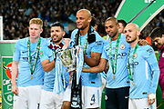 Kevin De Bruyne (17) of Manchester City, Sergio Aguero (10) of Manchester City, Vincent Kompany (4) of Manchester City, Fernandinho (25) of Manchester City and David Silva (21) of Manchester City pose with the Carabao Cup during the celebrations at full time during the EFL Cup Final match between Arsenal and Manchester City at Wembley Stadium, London, England on 25 February 2018. Picture by Graham Hunt.
