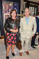 The HON.DOMINIC LAWSON and his wife The HON.ROSA LAWSON at a party to celebrate the opening of Mappin & Webb's Flagship Regent Street Boutique at 132 Regent Street, London on 28th June 2016.