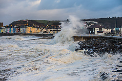 © Licensed to London News Pictures. 10/12/2014. Aberystwyth, UK Huge 40' waves, hit the seafront at Aberystwyth on the West coast of Wales today 10th December 2014. A 'weather bomb' of rapidly declining air pressure, bringing with it fierce winds gusting at over 100mph in Scotland. . Photo credit : Keith Morris/LNP