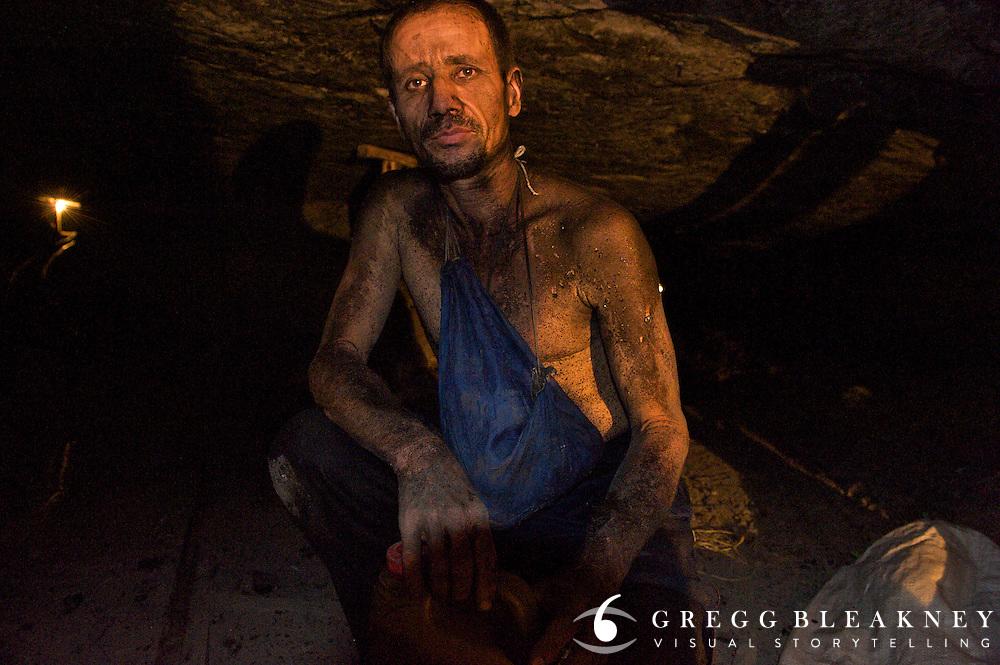 Portrait of coal miner biker in mine shaft during shift - Colombia